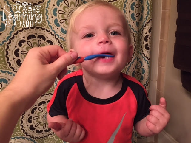 Toddler with Nuby All Natural Toddler Training Toothbrush & Toothpaste