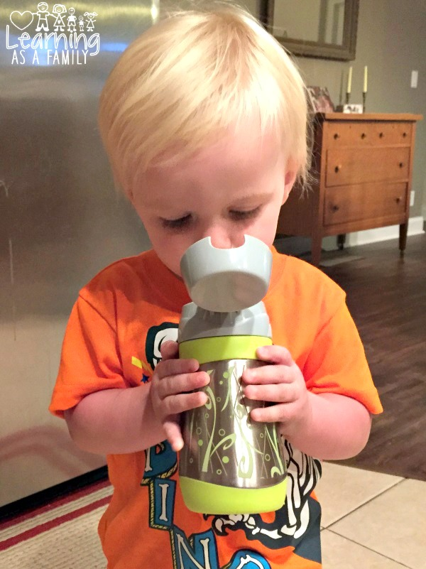 Toddler using a Nuby Insulated Stainless Steel No-Spill Flip-it