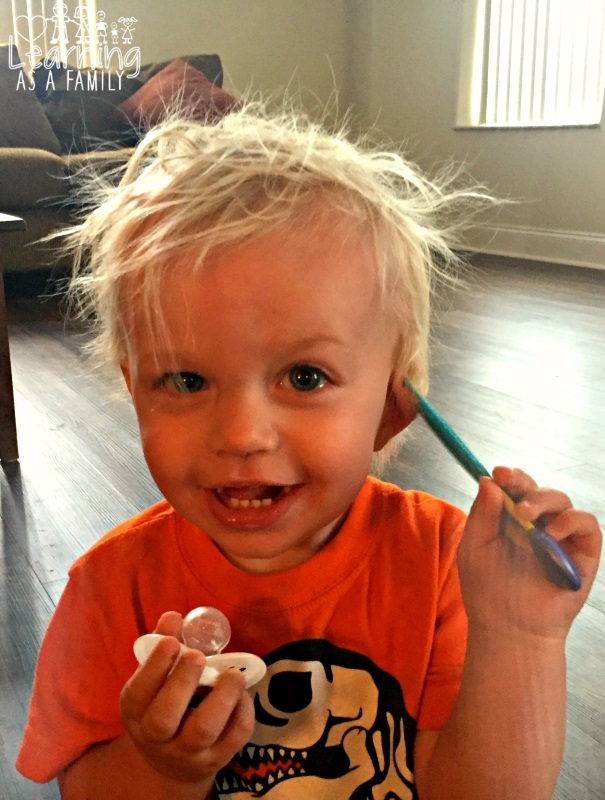 Toddler having fun with comb from Nuby Brush and Comb Set