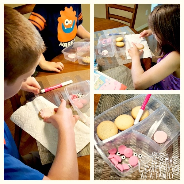 Kids Decorating Pig Cookies